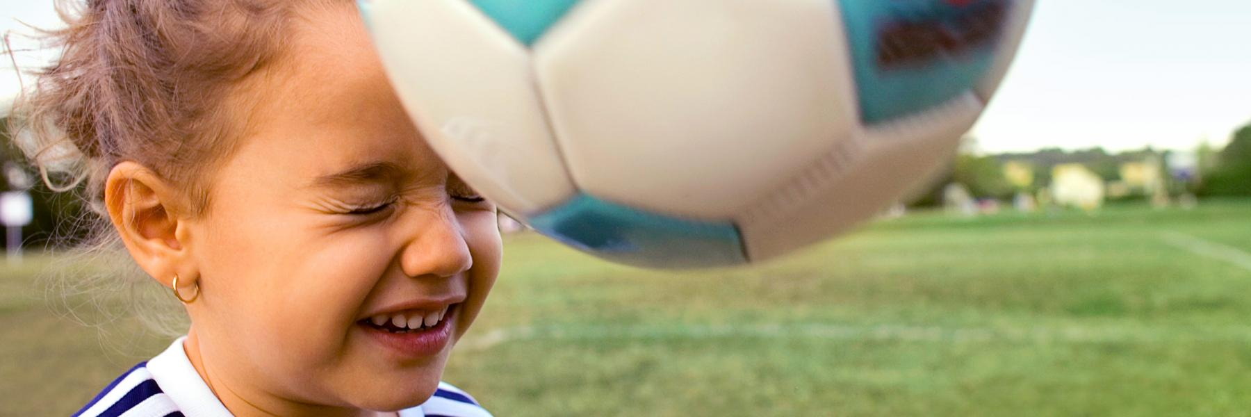 Little Girl Bouncing Soccer Ball